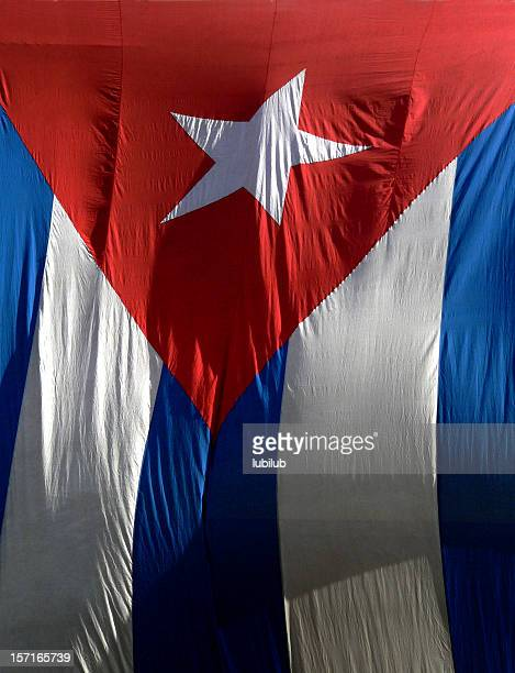 cuban flag hanging on a building in old havana, cuba - cuban flag stock pictures, royalty-free photos & images