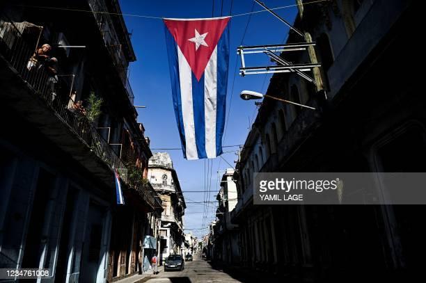 Cuban flag hangs in a street of Havana, on August 19, 2021.