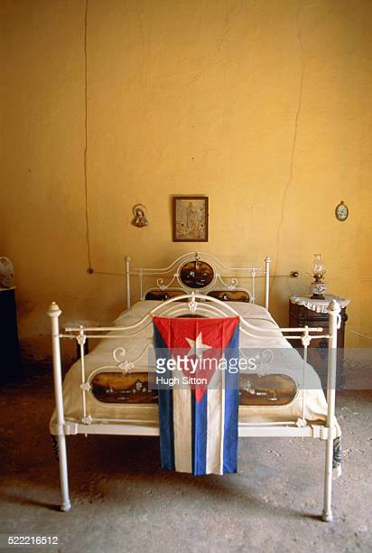 cuban flag in empty bedroom - hugh sitton stock pictures, royalty-free photos & images