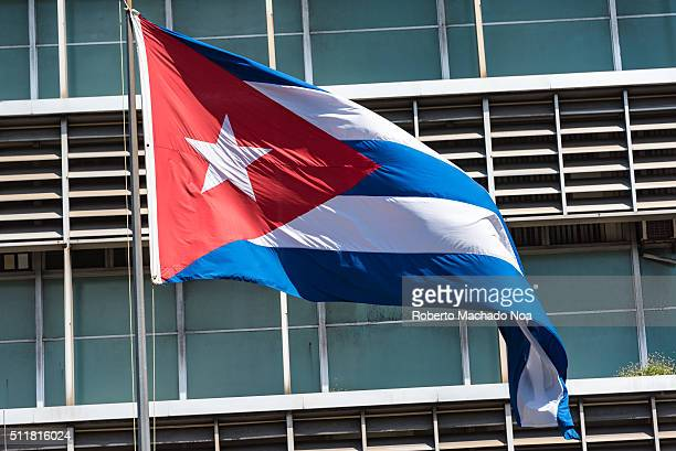 Cuban flag in pole with building design in the background The flag of Cuba consists of five blue and white alternating stripes and a red equilateral...