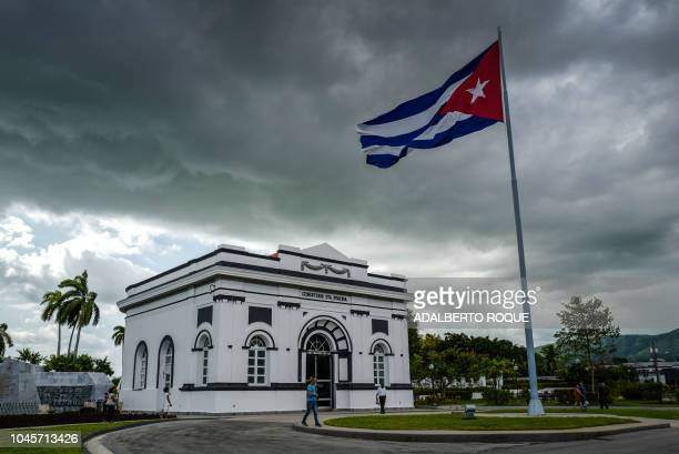 A Cuban flag is seen at the entrance of the Santa Ifigenia cemetery in Santiago de Cuba province Cuba on September 29 2018