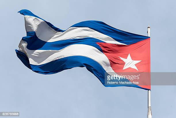 Cuban flag national symbol intensely waving in a blue sky