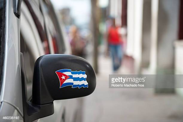 Cuban flag sticker in the rearview mirror of a car