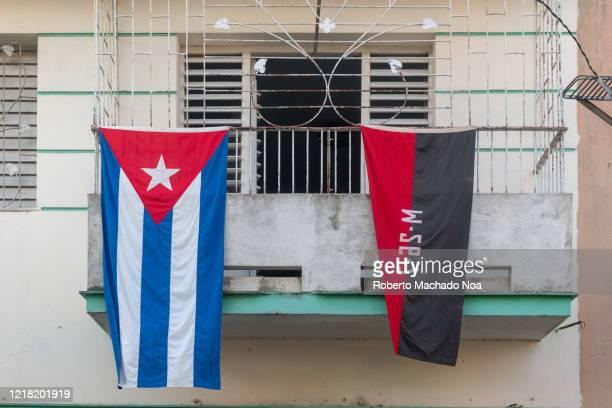 cuban flags hanging in balcony, santa clara, cuba - cuban flag stock pictures, royalty-free photos & images