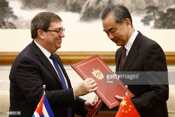 Cuban Foreign Minister Bruno Rodriguez and Chinese Foreign Minister Wang Yi attend a signing ceremony at Diaoyutai state guesthouse in Beijing, China...