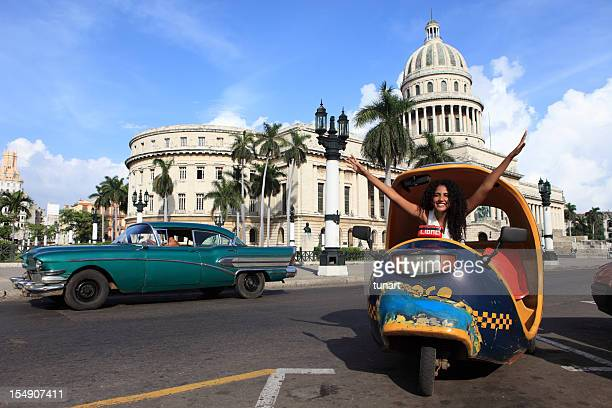Cuban Girl in Coco Taxi infront of Capitolio, Havana, Cuba