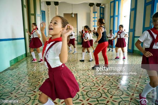 Cuban girl smiles as pioneers dance during a music class held in the Casa de la Cultura on October 17 in Remedios in the province of Villa Clara Cuba...