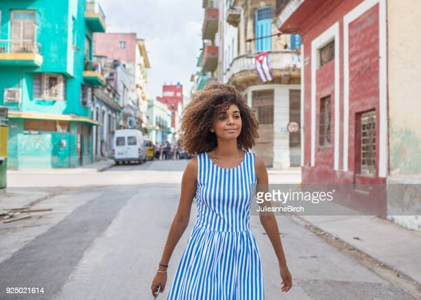 Cuban girl walking through streets of Havana