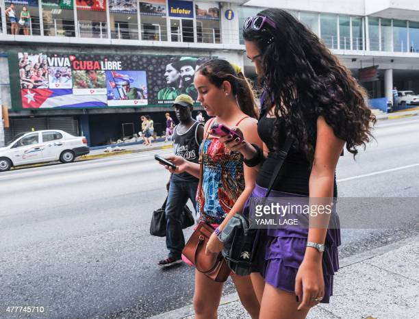 Cuban girls use their mobile phones in a street of Havana on June 19 2015 Cuban stateowned telecommunications company Etecsa announced Thursday that...