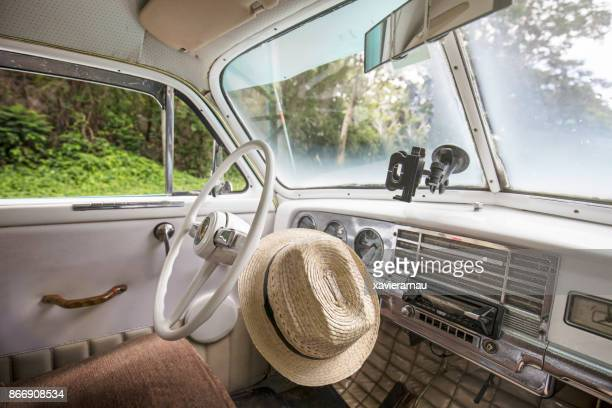 cuban hat inside a vintage car in cuba - obsolete stock pictures, royalty-free photos & images