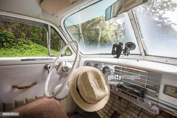 Cuban hat inside a vintage car in Cuba