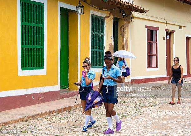 Cuban high scool students in Trinidad Cuba After removing the interned schools the high school students can be seen once more in their daily routine...