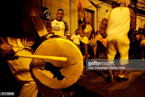 Cuban hits his broken drum as conga groups march through the streets during the Camaguey carnival June 24 2008 in Camaguey Cuba The first day...