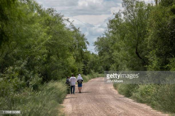 Cuban immigrants walk after crossing the border from Mexico on July 02, 2019 in McAllen, Texas. The immigrants, most from Central America, had rafted...