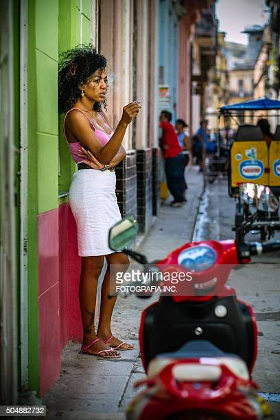 cuban lady on havana street - mother and daughter smoking stock photos and pictures