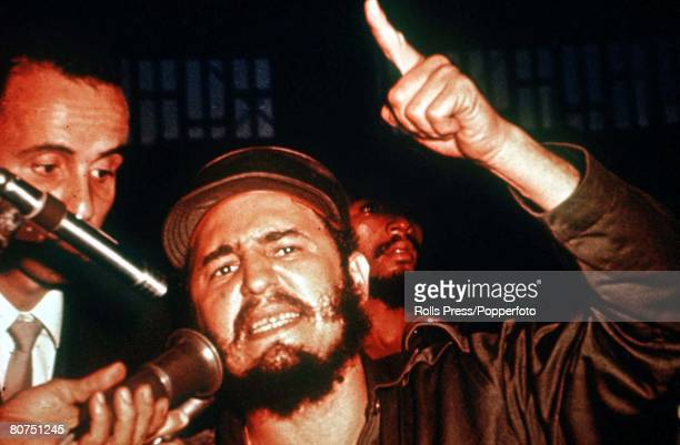 Cuban leader Fidel Castro gestures with his hands while making a speech