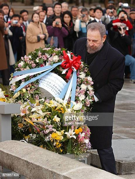 Cuban leader Fidel Castro offers a wreath at a cenotaph for the victims of the 1945 US atomic bombing of the western Japanese city of Hiroshima in...