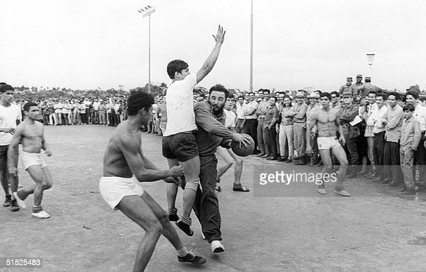 Cuban leader Fidel Castro Ruz plays basketball with students of Ceiba I agriculture high school near Havana in 1970