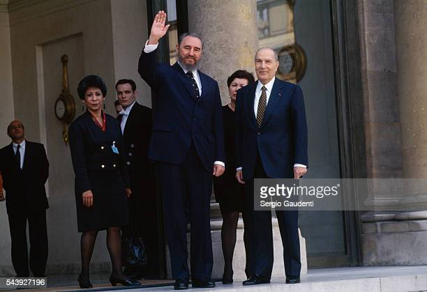 Cuban leader Fidel Castro waves from the steps of the Elysee Palace after a meeting with his French counterpart Francois Mitterrand