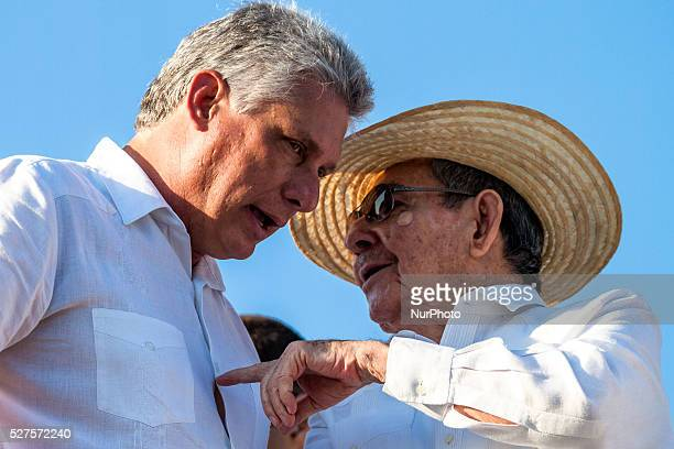 Cuban leader Raul Castro talks with the First Vice President of Cuba Miguel DiazCanel while watching the parade in Revolutionary Square in Havana...