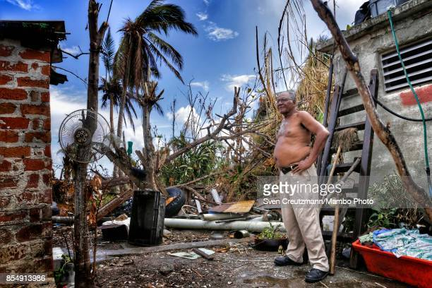Cuban Leonardo Fernandez stands in front of his house 12 days after Hurricane Irma passed over Cuba on September 22 2017 in Caibarien province of...