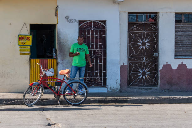 Cuban man eating at a private small business, Santa Clara, Cuba