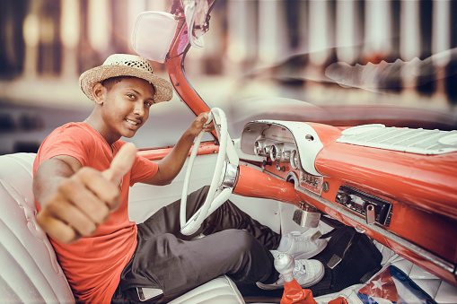 Cuban man giving Ok sign driving vintage car in Cuba Old Havana - gettyimageskorea