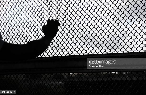 Cuban man seeking asylum waits along the border bridge after being denied into the Texas city of Brownsville which has become dependent on the daily...