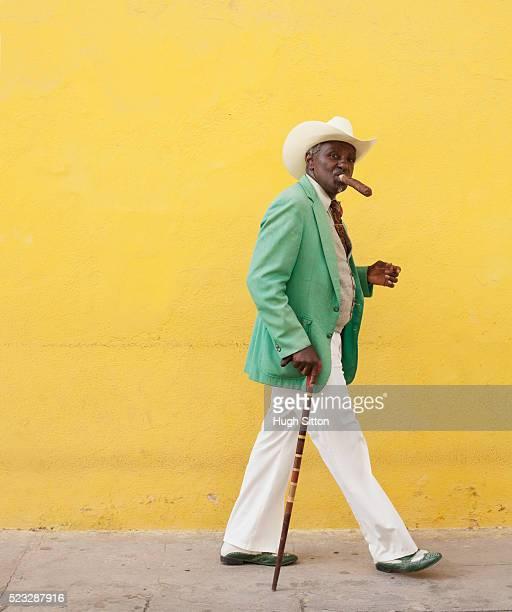 cuban man smoking cigar - hugh sitton stock pictures, royalty-free photos & images