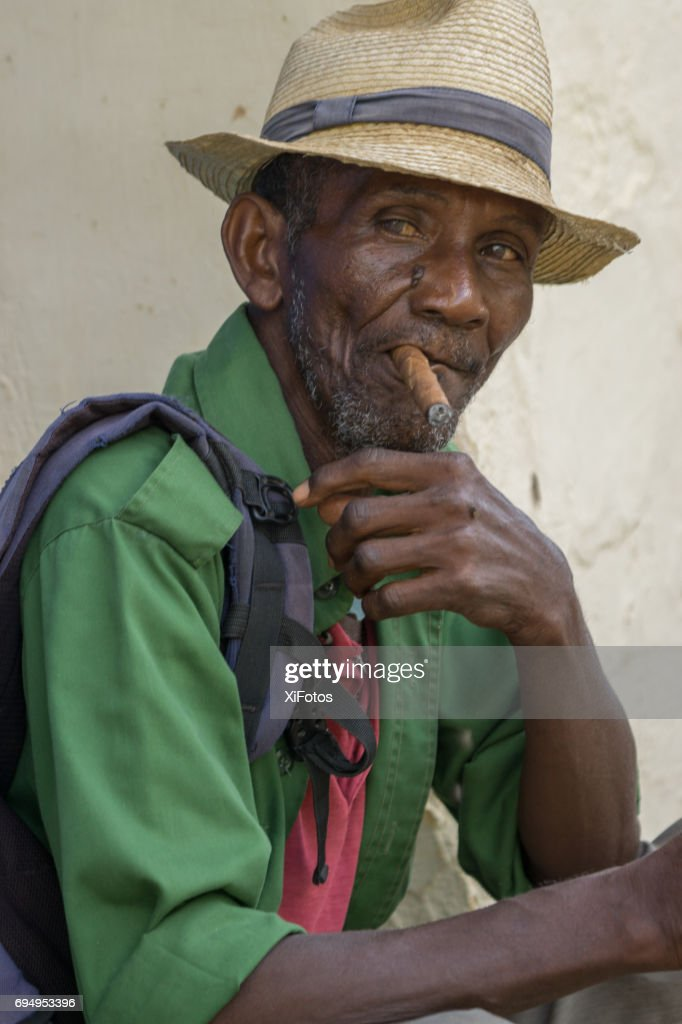 92b325cd8 Cuban Man Smoking Cigar Stock Photo | Getty Images