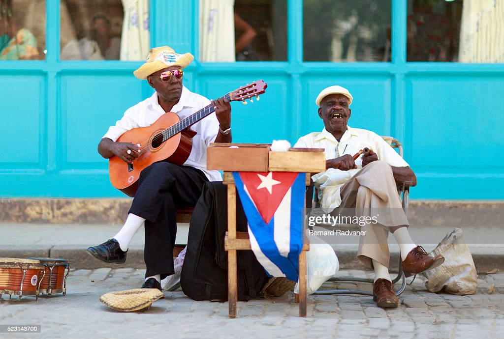 2 cuban men playing music in havana street : Stock Photo