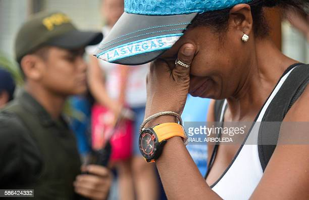 A Cuban migrant cries before boarding a vessel to Capurgana in the Caribbean Gulf of Uraba in northwestern Colombia to illegally cross to Panama...