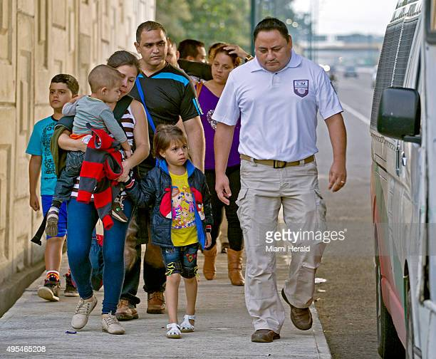 Cuban migrants are loaded onto buses to be driven to and processed at the Mexican National Institute of Migration shortly after they had crossed the...