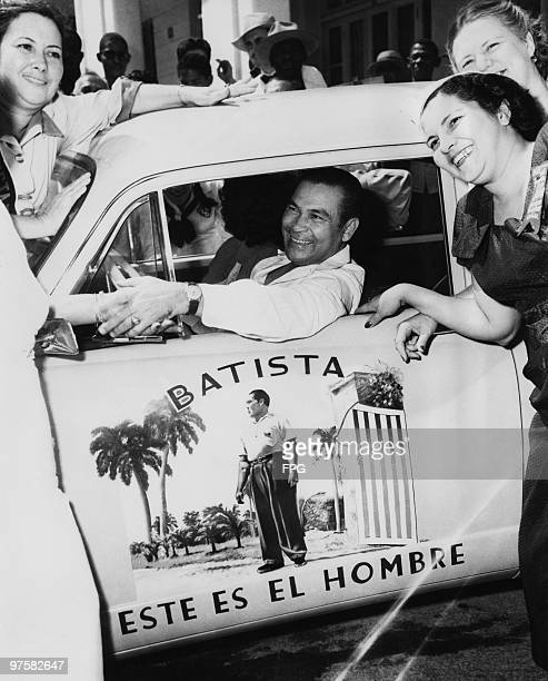 Cuban military and political leader Fulgencio Batista drives through the streets of Havana greeting his loyal fans March 1952 He was President of...