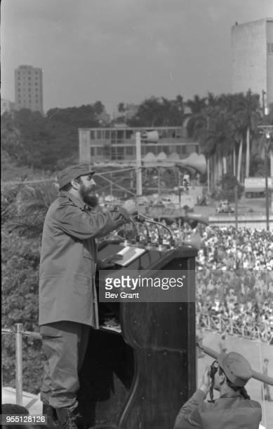 Cuban military and political leader Prime Minister Fidel Castro speaks from a podium in la Plaza de la Revolucion during the 10th anniversary...