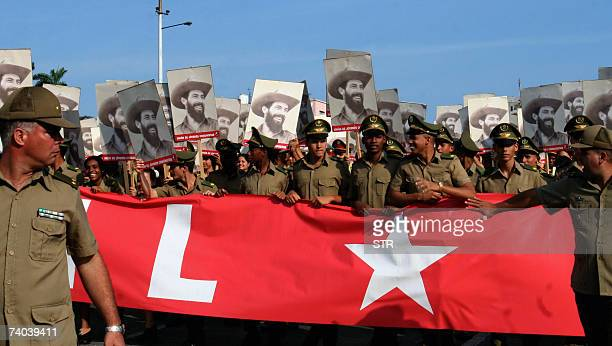 Cuban military cadets show portraits of the revolutionary hero Camilo Cienfuegos at the Revolution Square in Havana during the May Day parade 01 May...