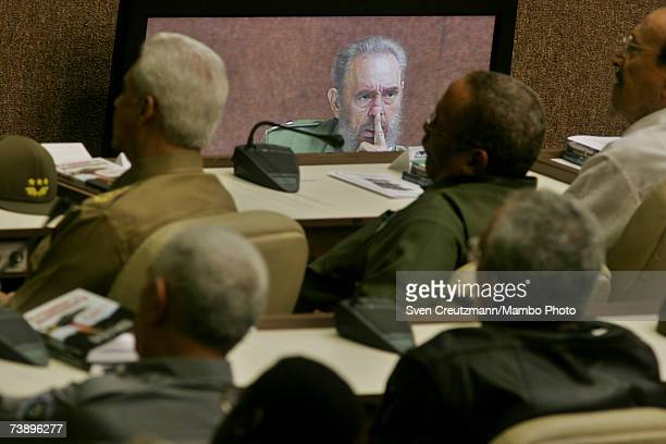 Cuban military officers attend a speech by Fidel Castro December 12, 2005 which is also projected on tv monitors, during the celebrations for the...