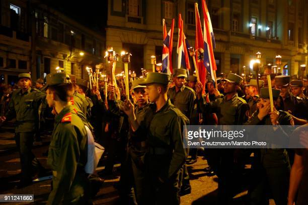 Cuban military personnel walk during a march as Cuba celebrates the 165 anniversary of the birth of its national hero Jose Marti on January 27 in...