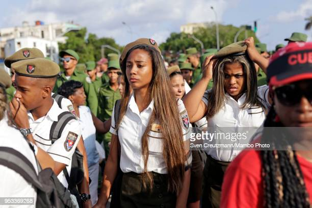 Cuban military students carry a flag during the march to celebrate workers day at the Revolution Square on May 1 in Havana Cuba The march is the...