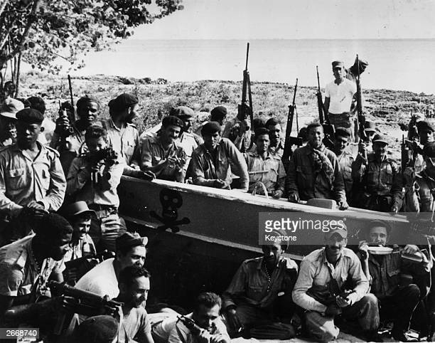 Cuban militiamen and members of the Revolutionary Army celebrating their victory over US mercenaries at Playa Giron in what became known as the Bay...