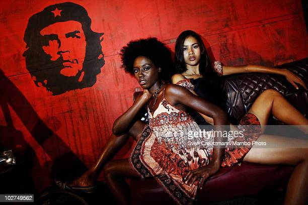 Cuban models of the KINGS OF SALSA, a show by british theater director Jon Lee, pose during a photoshoot in a garage against the backdrop of the Che...