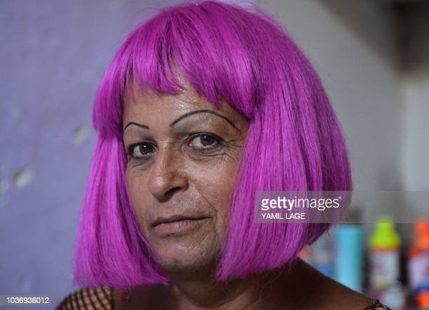 Cuban municipal councilor Jose Agustin Hernandez aka 'Adela' member of the LGBT community wears his favorite wig at his home in Caibarien Villa Clara...