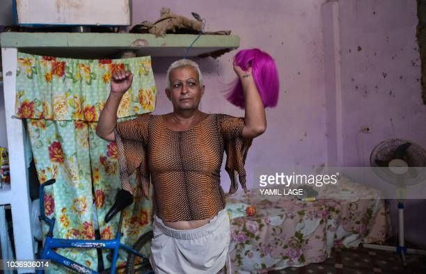 Cuban municipal councilor Jose Agustin Hernandez aka 'Adela' member of the LGBT community shows his favorite wig at his home in Caibarien Villa Clara...