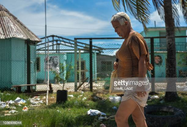 Cuban municipal councilor Jose Agustin Hernandez aka 'Adela' member of the LGBT community walks in Caibarien Villa Clara province Cuba on August 26...