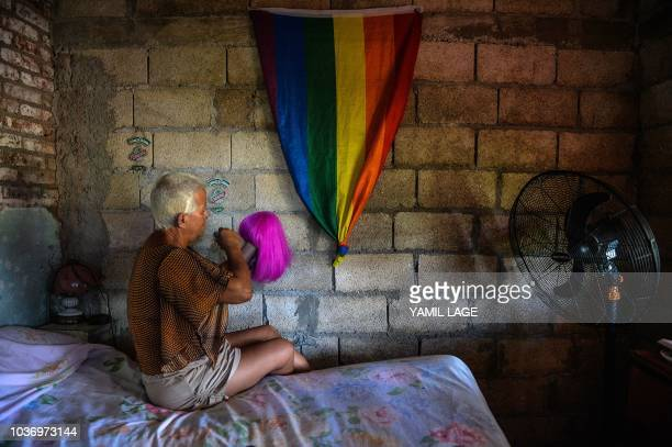 Cuban municipal councilor Jose Agustin Hernandez aka 'Adela' member of the LGBT community prepares his favorite wig at his home in Caibarien Villa...