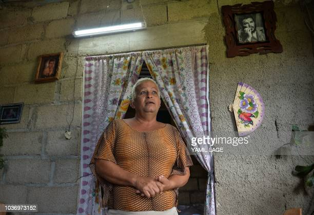 Cuban municipal councilor Jose Agustin Hernandez aka 'Adela' member of the LGBT community speaks with AFP at his home in Caibarien Villa Clara...