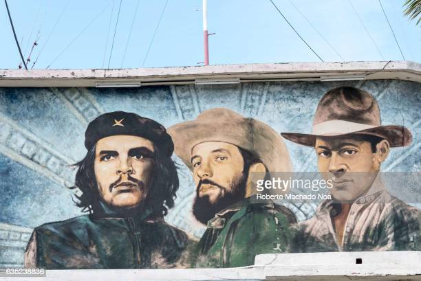 Cuban mural painting with fallen heroes From left to right Che Guevara Camilo Cienfuegos and Julio Antonio Mella