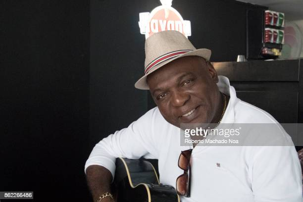 Cuban musician playing his acoustic guitar in a restaurant