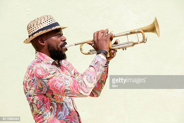 cuban musician playing trumpet, havana, cuba - yellow hat stock pictures, royalty-free photos & images