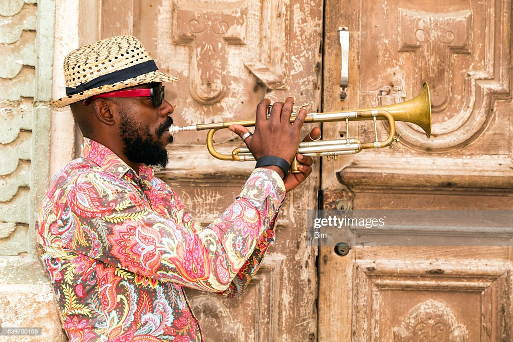 Cuban musician playing trumpet in Havana : Stock Photo